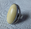 N.E.From faux ivory ring, very small finger  J