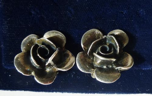 Silver rose ear clips