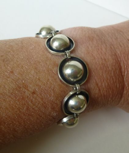 Silver bracelet with silver cabochons