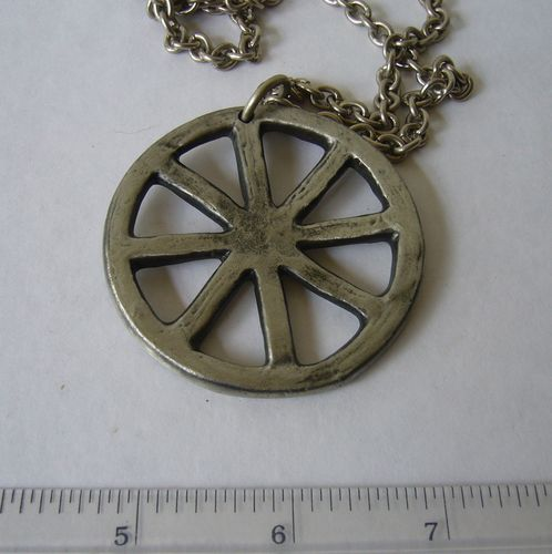 ÅA pewter wheel pendant