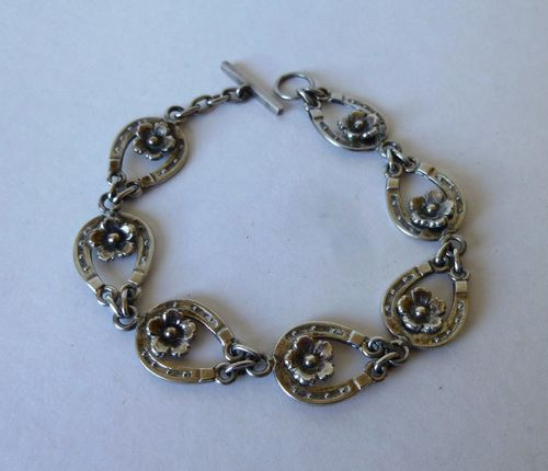 N.E.From Sterling horseshoe bracelet