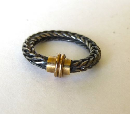 Braided oxidised ring with gold band, N