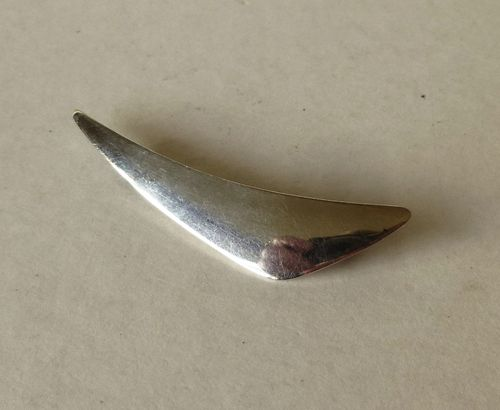 N.E.From Sterling silver boomerang brooch
