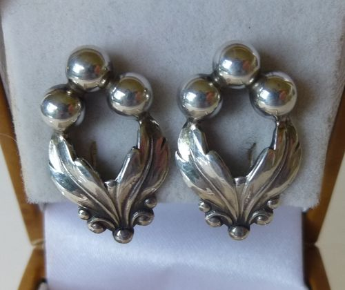 N.E.From Sterling silver ear clips